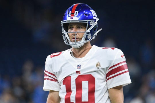New York Giants quarterback Eli Manning (10) looks on before a game against the Detroit Lions at Ford Field on Aug 17, 2018.