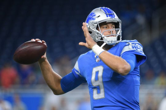 Detroit Lions quarterback Matthew Stafford (9) warms up before a game against the New York Giants at Ford Field on Aug. 17, 2018.