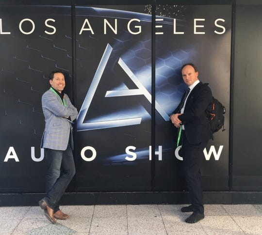 Bryson Bort, left, founder of Grimm, and Matt Carpenter, principal automotive researcher, at the Los Angeles Auto Show in November 2017, where they spoke on security issues of connected and automated vehicles.