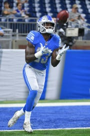 Detroit Lions running back Kerryon Johnson (33) warms up before a game against the New York Giants at Ford Field on Aug 17, 2018.