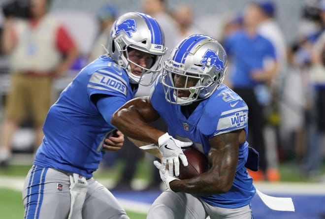 Detroit Lions quarterback Jake Rudock hands off to running back Ameer Abdullah during warmups before a preseason football game against the New York Giants, Friday, Aug. 17, 2018, in Detroit.