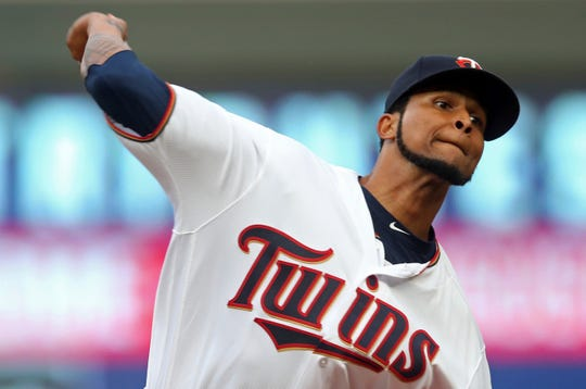 Minnesota Twins pitcher Ervin Santana throws to a Detroit Tigers batter during the first inning of a baseball game Thursday, Aug. 16, 2018, in Minneapolis.