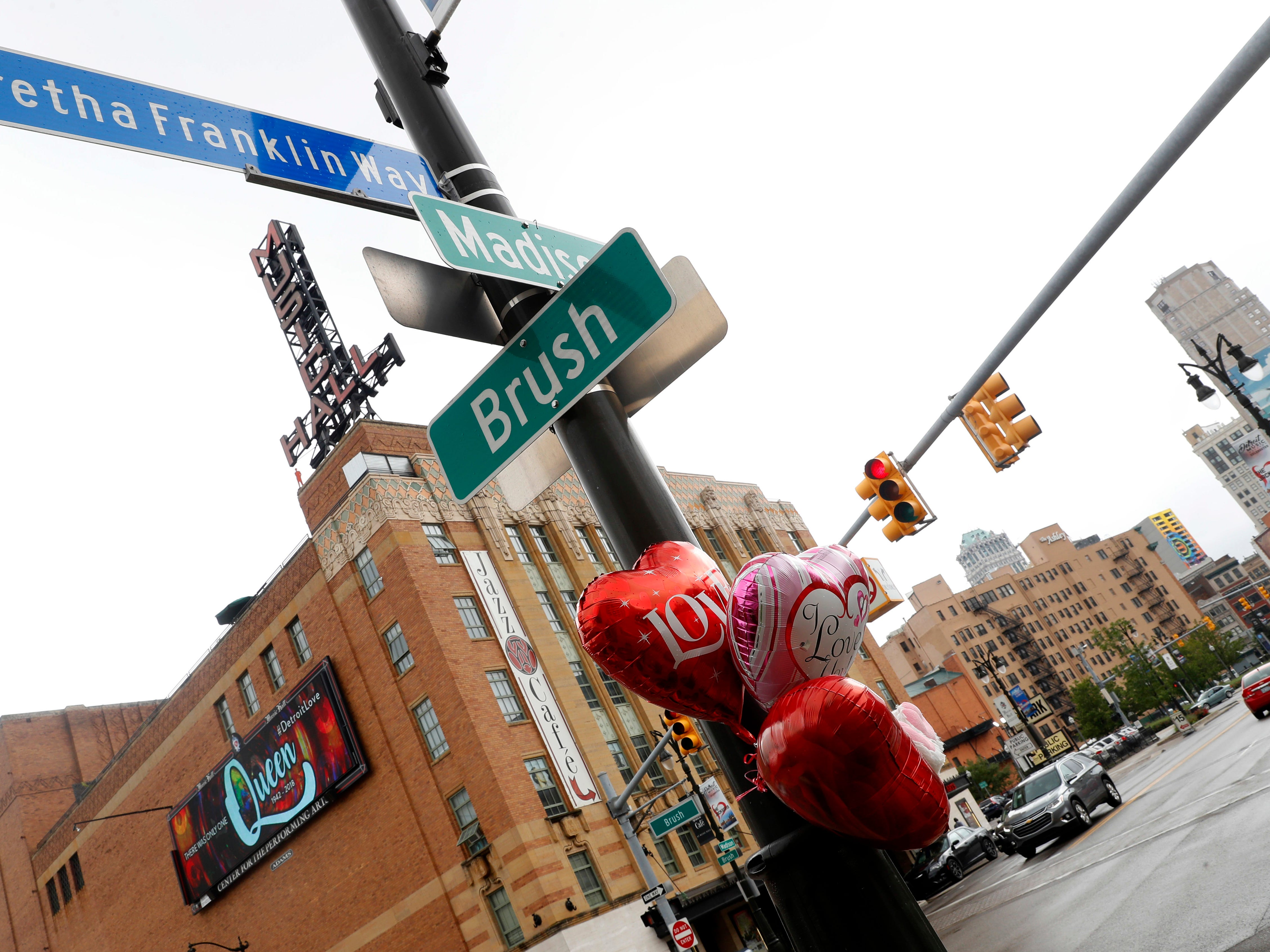 Balloons hang in Aretha Franklin's honor on a street post at Aretha Franklin Way in Detroit, Thursday.