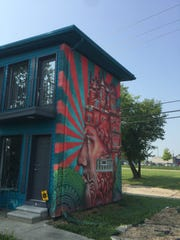 This arty house is a short-term rental through Airbnb near Eastern Market in Detroit.