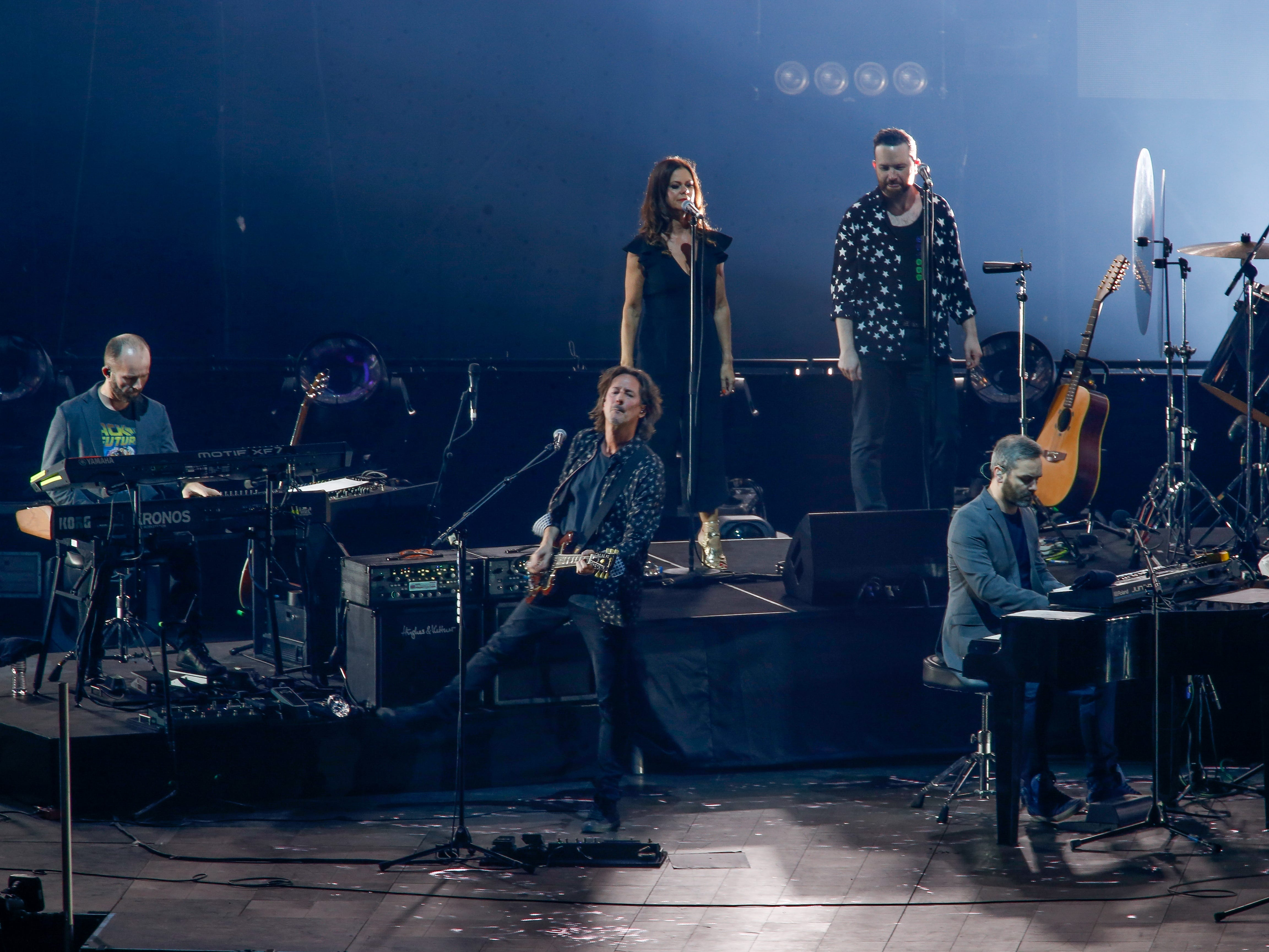 Keyboardist Joe Webb, left, guitarist Milton McDonald, center, and pianist Marcus Byrne, right, with backing vocalists Melanie Lewis McDonald and Iain Hornal. All are part of Jeff Lynne's ELO.