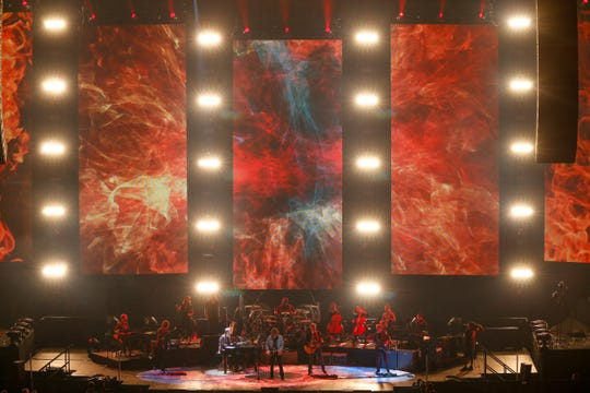 "Jeff Lynne's ELO is a 12-member ensemble, featuring cellos, violins, and three keyboards. In this picture, the band is performing its classic hit ""Evil Woman."""