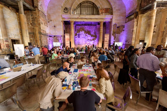 Young entrepreneurs brainstorm ideas Friday for how Ford should develop the Michigan Central Depot train station into a workspace that will entice people to want to work there.