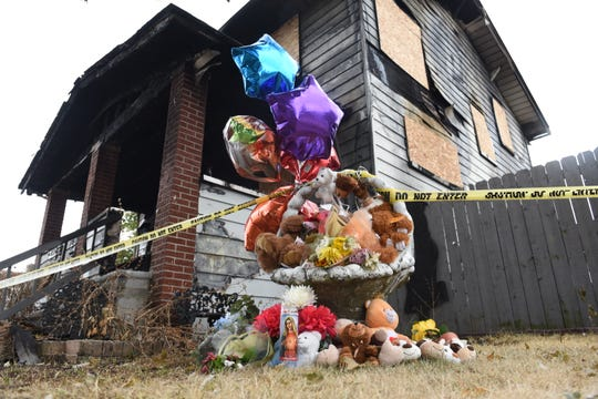 A memorial  sits outside the house in the 600 block of Mayflower Avenue in Lincoln Park where three people died in a house fire on August 11, 2018.