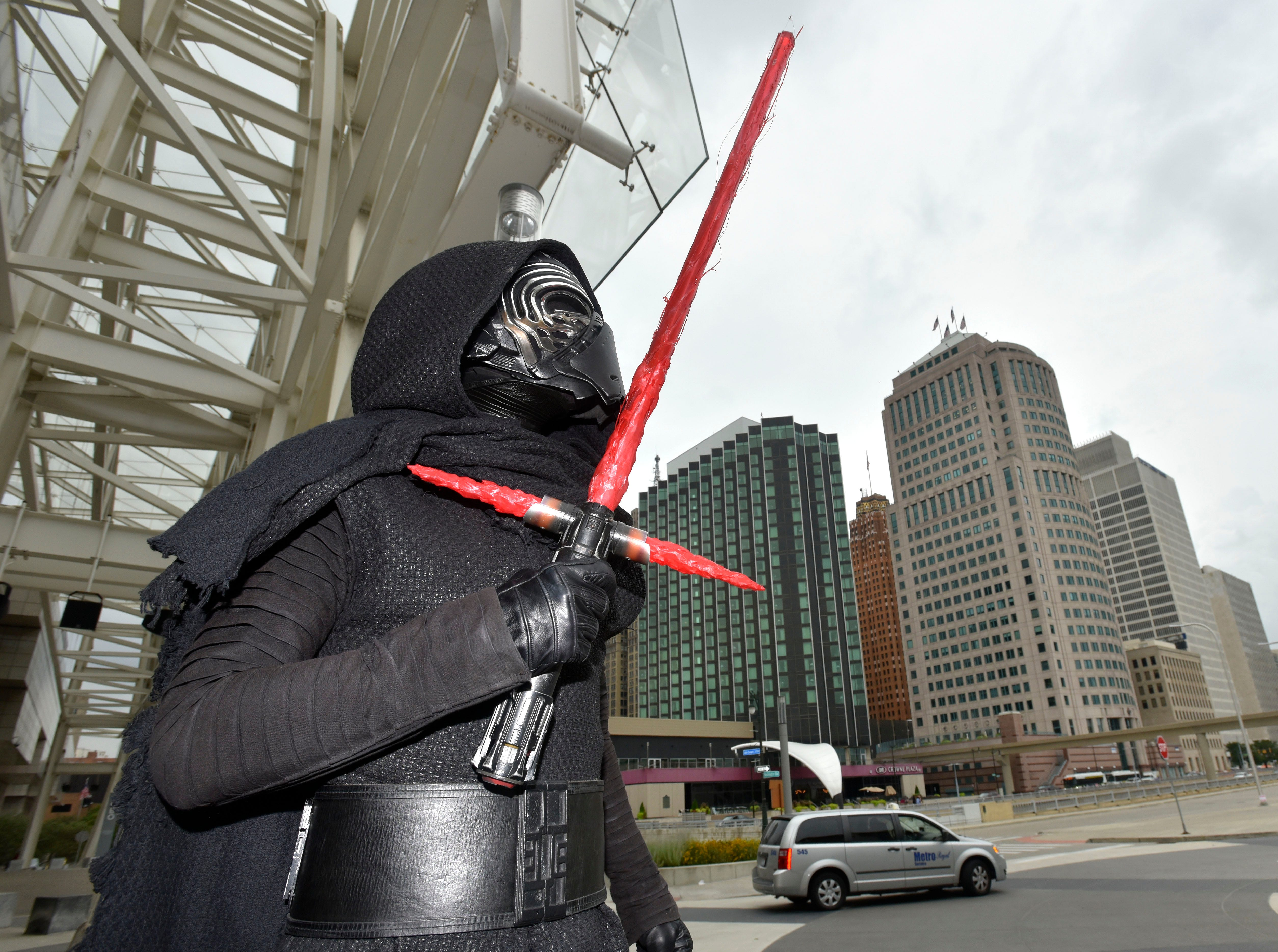"Ryan Lientz, 40, of Rochester Hills portrays ""Kylo Ren"" from ""Star Wars: The Force Awakens"" on Friday, Aug. 17, 2018 as comic book and sci-fi enthusiasts converge on Cobo Center in downtown Detroit for the  Michigan Comic Con."