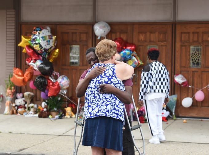 Terence Blair of Detroit hugs Melody Hause of Auburn Hills as they grieve outside the New Bethel Baptist Church in Detroit, where memorials to Aretha Franklin were collecting on Friday, August 17, 2018.