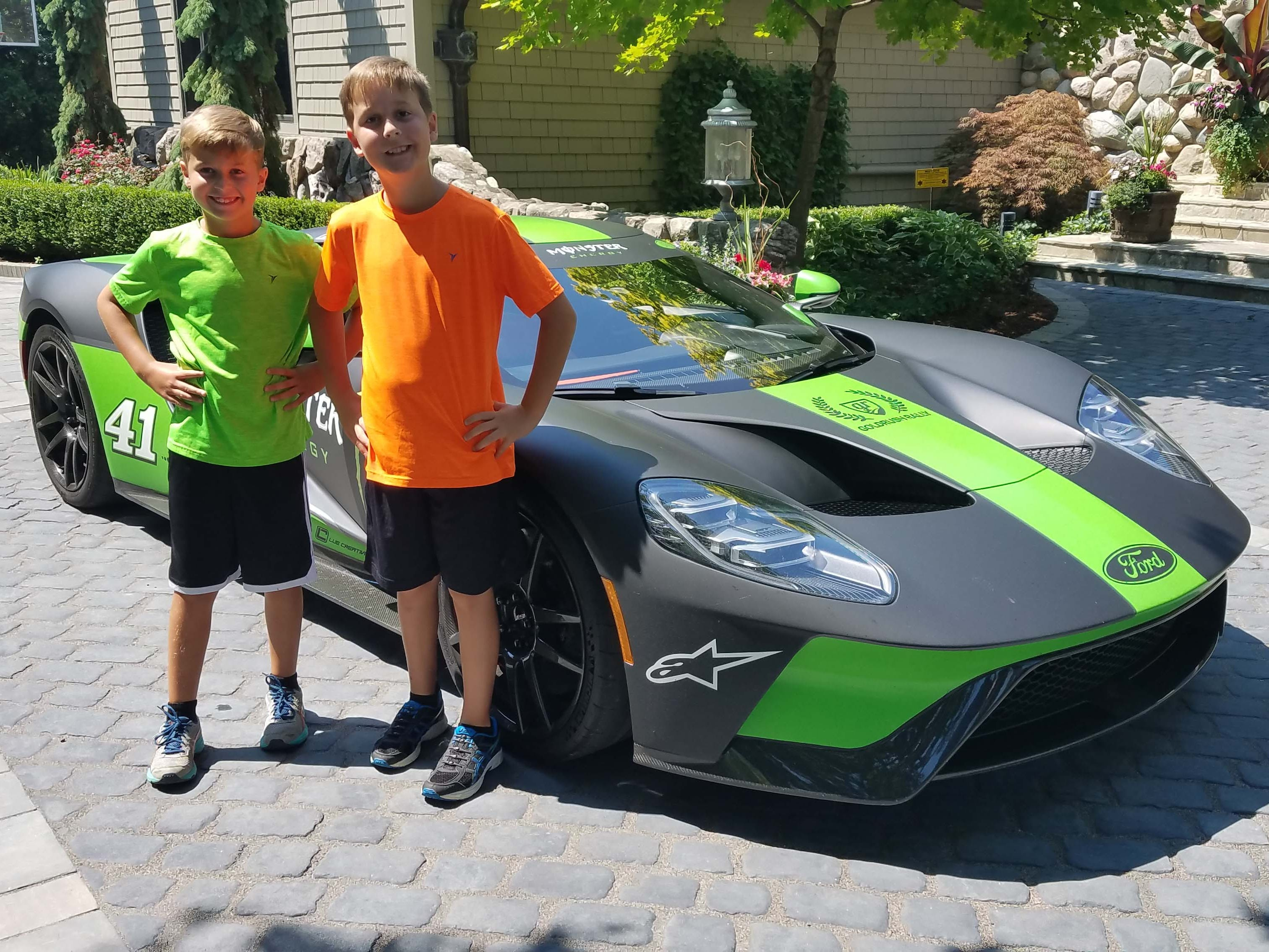 It's all about the kids. Kurt Busch's Ford GT thrills some neighborhood kids - and left them begging for more after Detroit News auto critic Henry Payne gave them a quick spin (courtesy of the NASCAR star).