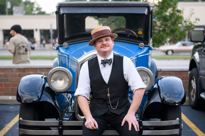 Rusty Berg of Highland sits with his 1927 Buick Standard after cruising on Woodward in Royal Oak, Aug. 16, 2018.