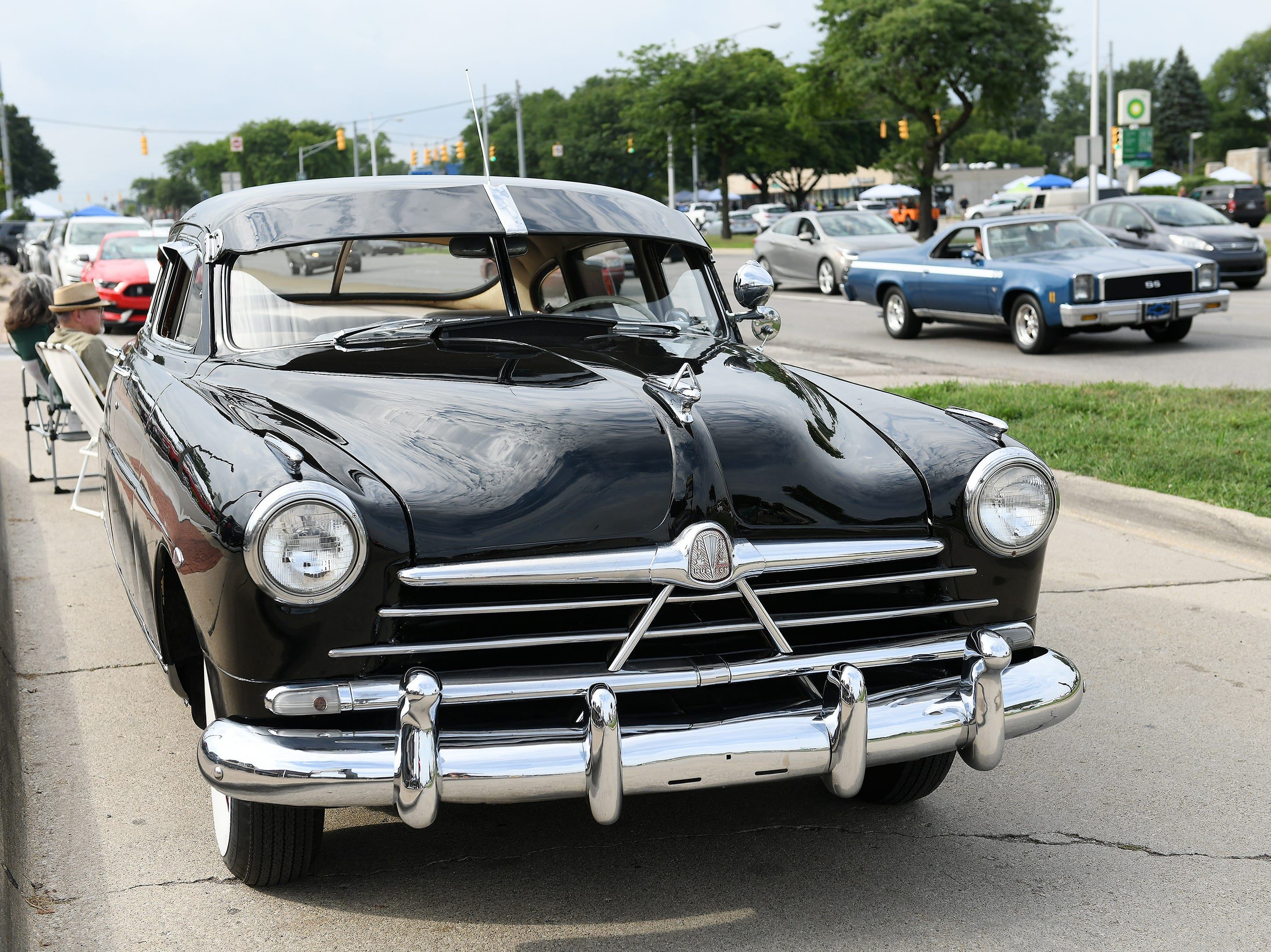 Heidi and Duane Sabella's 1950 Hudson Super Six sits on display along Woodward in Berkley Friday night.