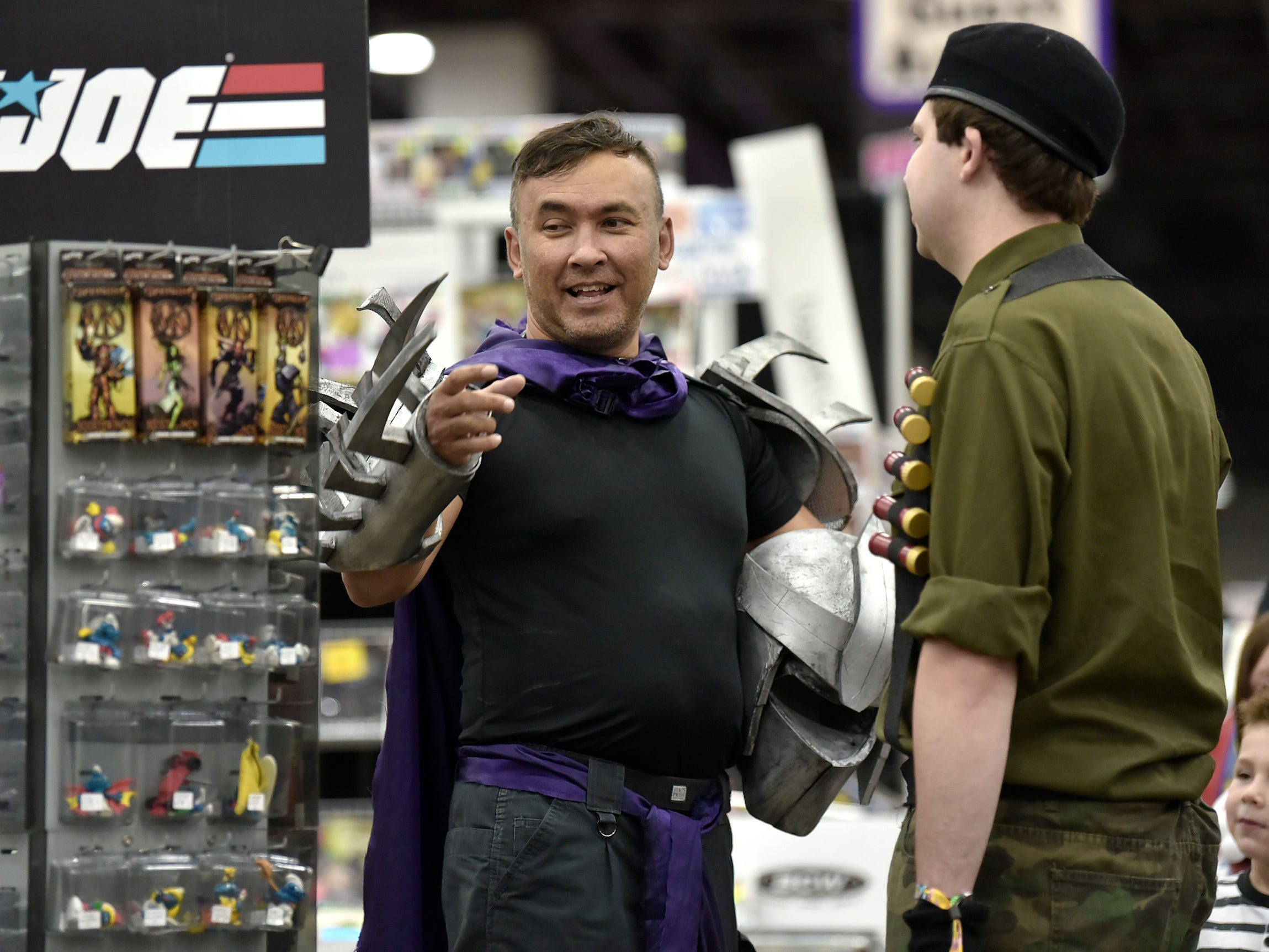 "John McKee, left, 45, of Ferndale clad as ""The Shredder"" from the Teenage Mutant Ninja Turtles series, talks with Jeremy Krause, 31, of Troy, who portrays ""Flint"" from G.I. Joe."