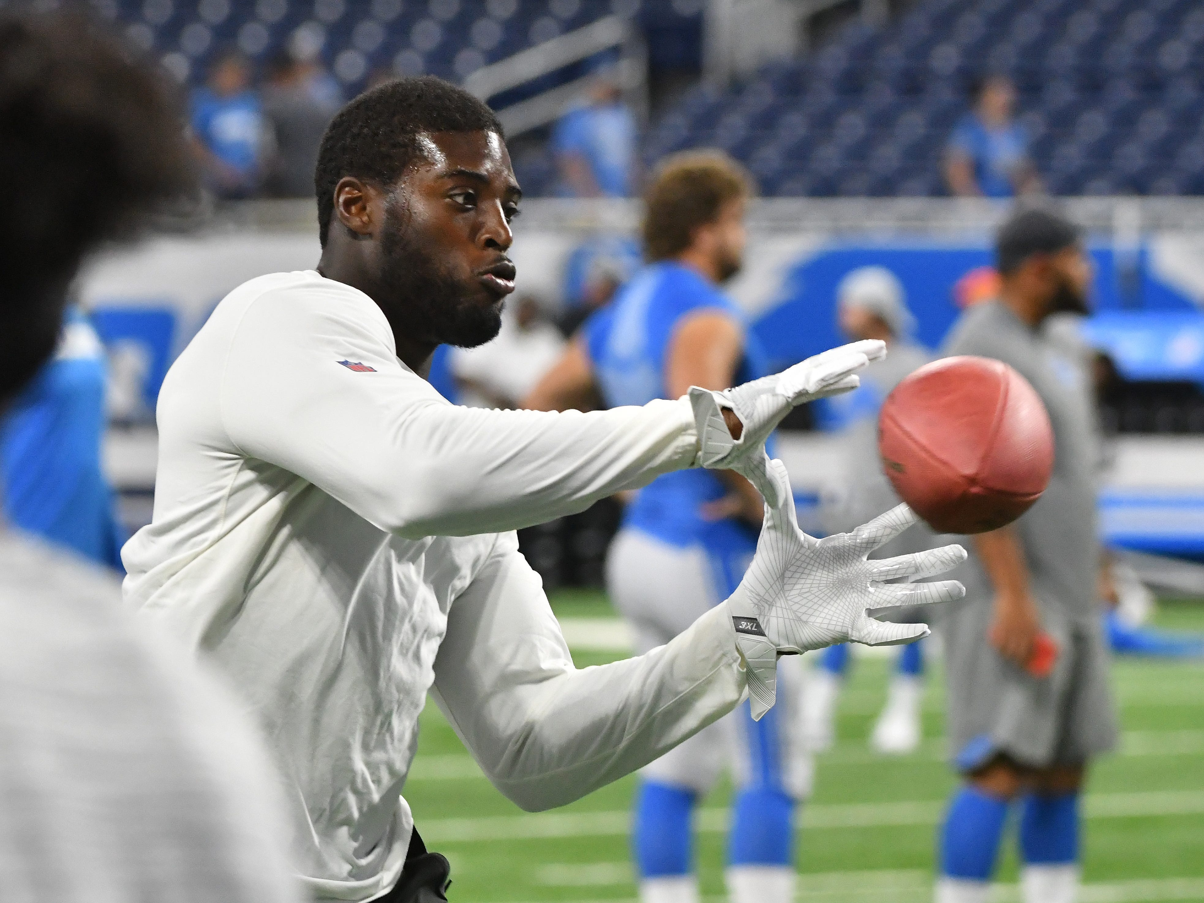 Lions' Jarrad Davis readies his hands for a reception during warmups as Detroit takes on the New York Giants at Ford Field in Detroit, Michigan on August 17, 2018. .
