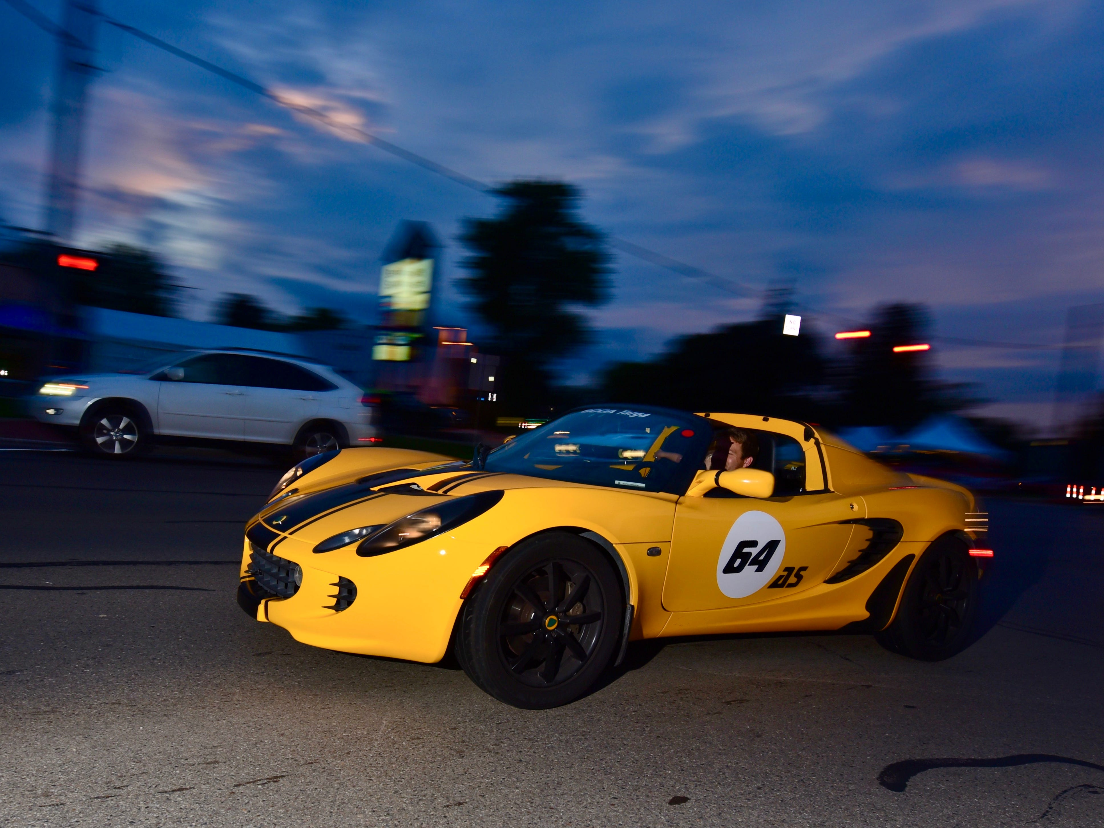A flash of yellow zips by as cruisers take to Woodward Thursday night, preceding the big day Saturday and the 2018 Woodward Dream Cruise.