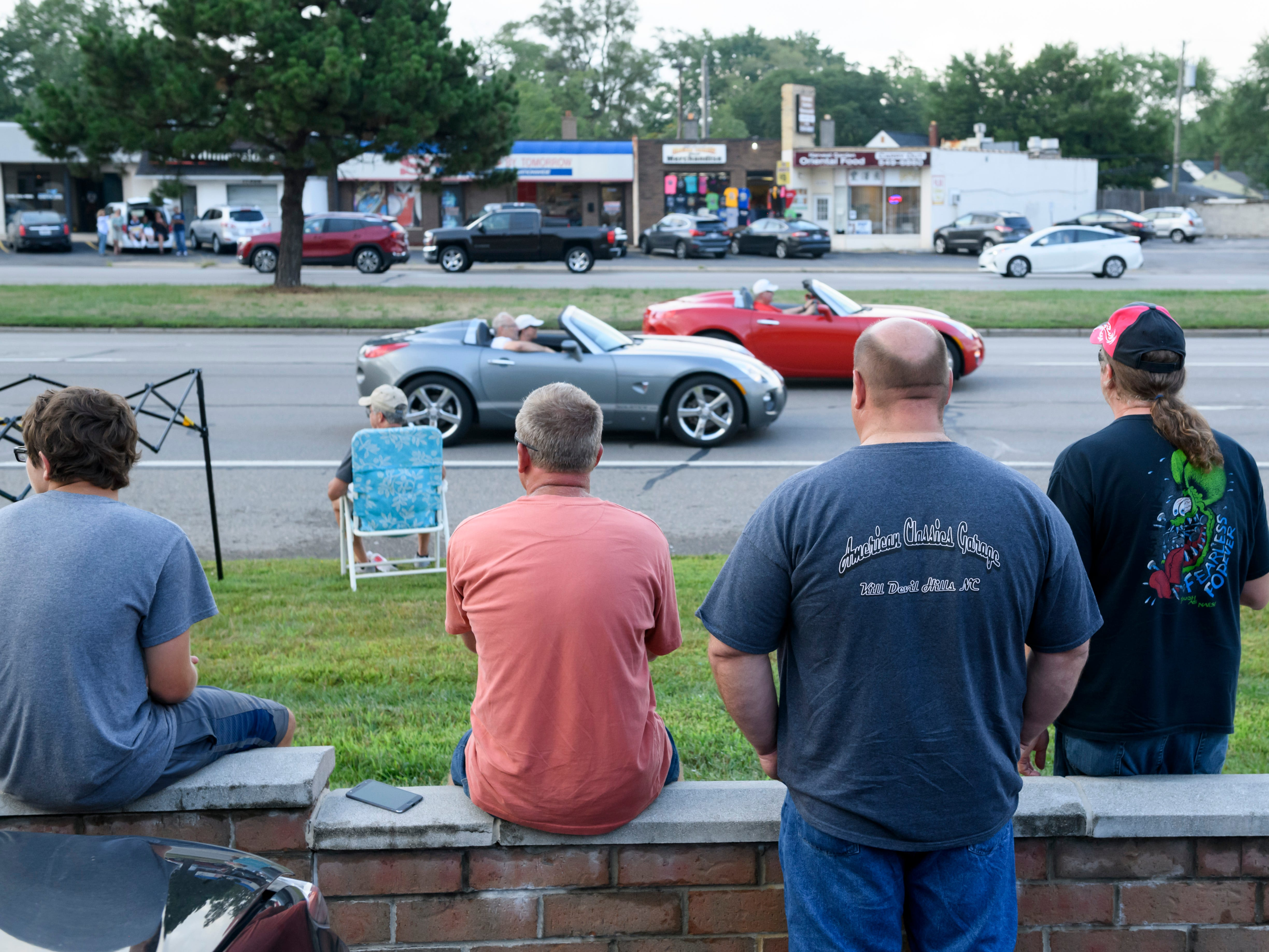 Groups of people line Woodward near Normandy in Royal Oak to watch cars cruise past, Aug. 16, 2018.