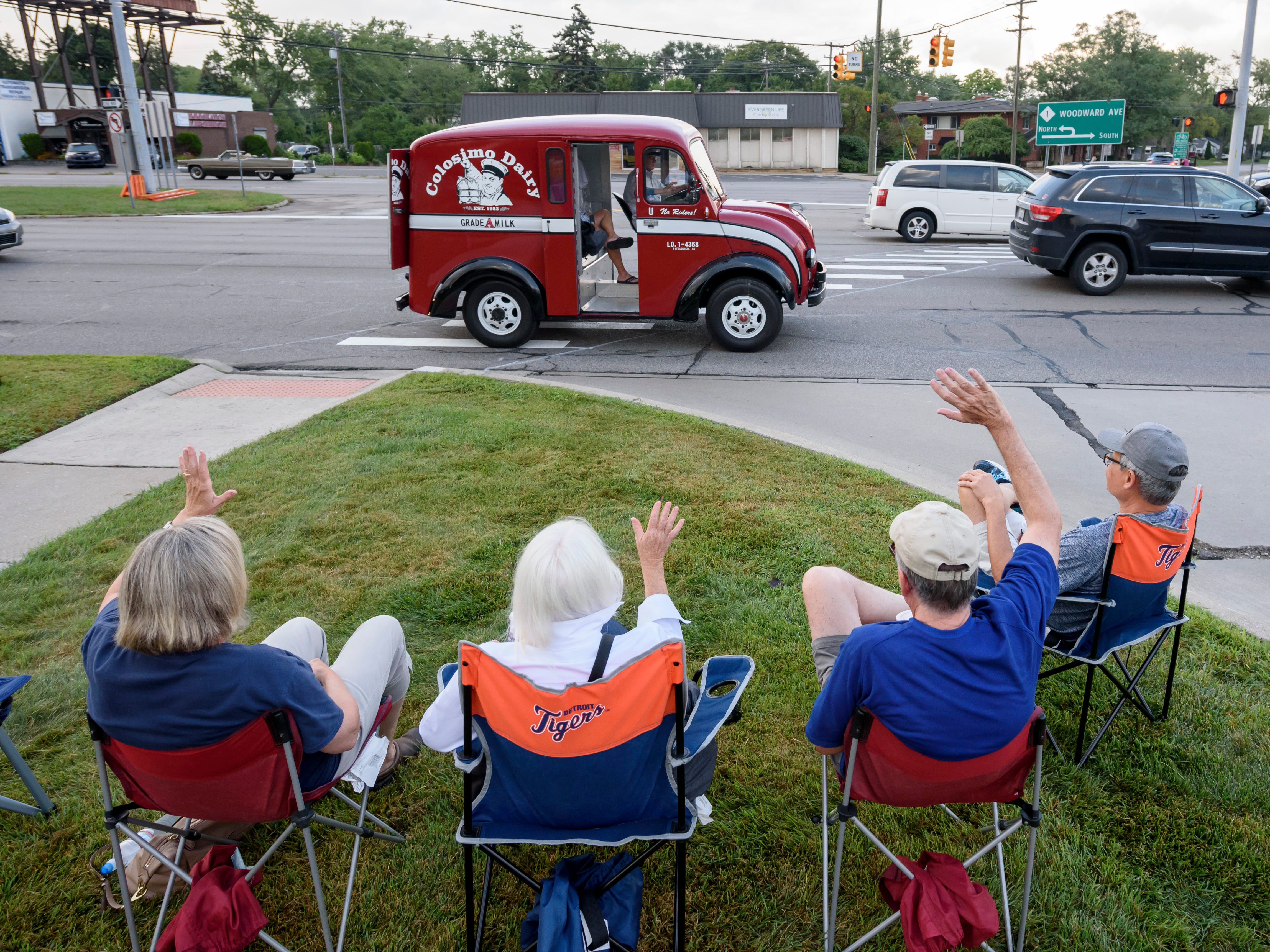Spectators wave to a 1957 DIVCO milk truck owned by Gary Colosimo of Pittsburgh on Woodward near Normandy in Royal Oak on Aug. 16, 2018.