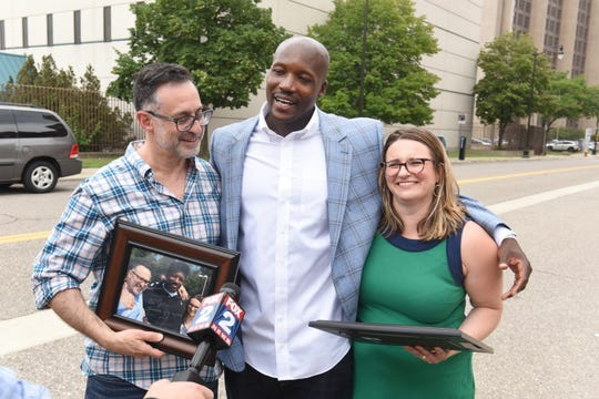 Aaron Salter, center, celebrates his exoneration and release from prison with Jonathan Epstein and Colleen Fitzharris, both of the Federal Defender Office.