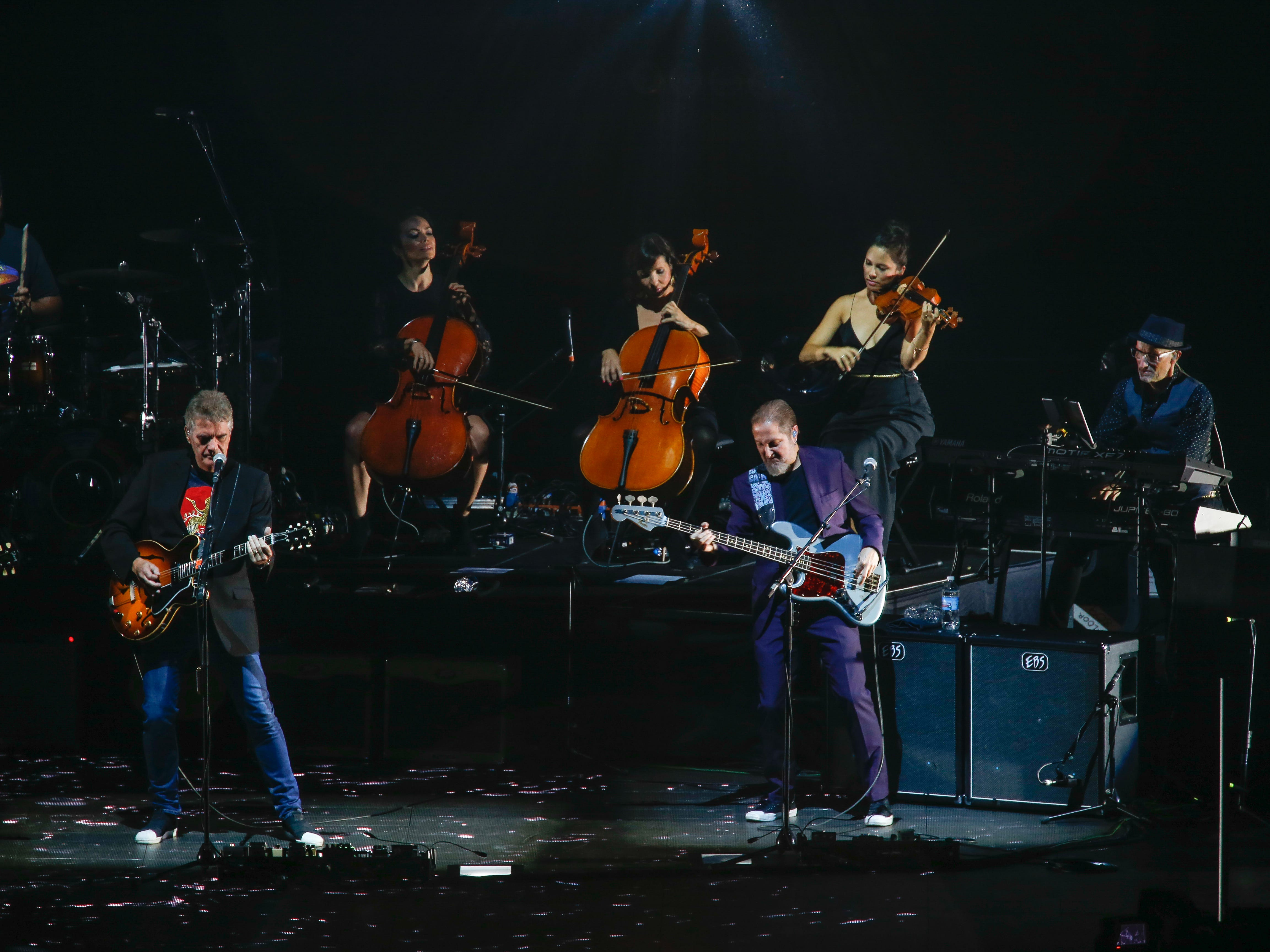 Guitarist Mike Stevens, left, and Lee Pomeroy, right, with ELO drummer Donovan Hepburn, cellists Amy Langley and Jessica Cox, violinist Rosie Langley and keyboard player Steve Turner.