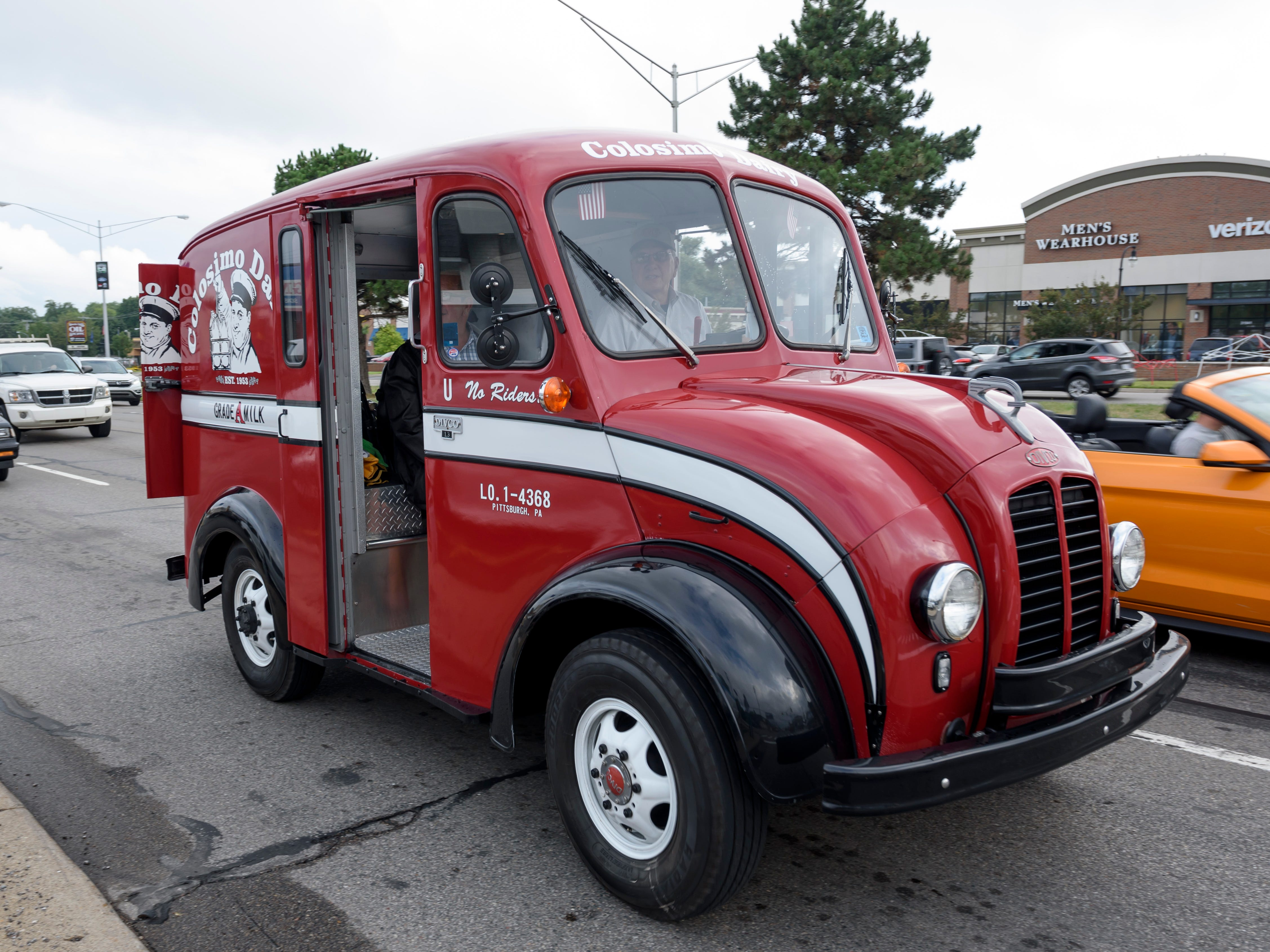 A 1957 DIVCO milk truck owned by Gary Colosimo of Pittsburgh makes its way down Woodward near Normandy in Royal Oak in preparation for the Dream Cruise, Aug. 16, 2018.