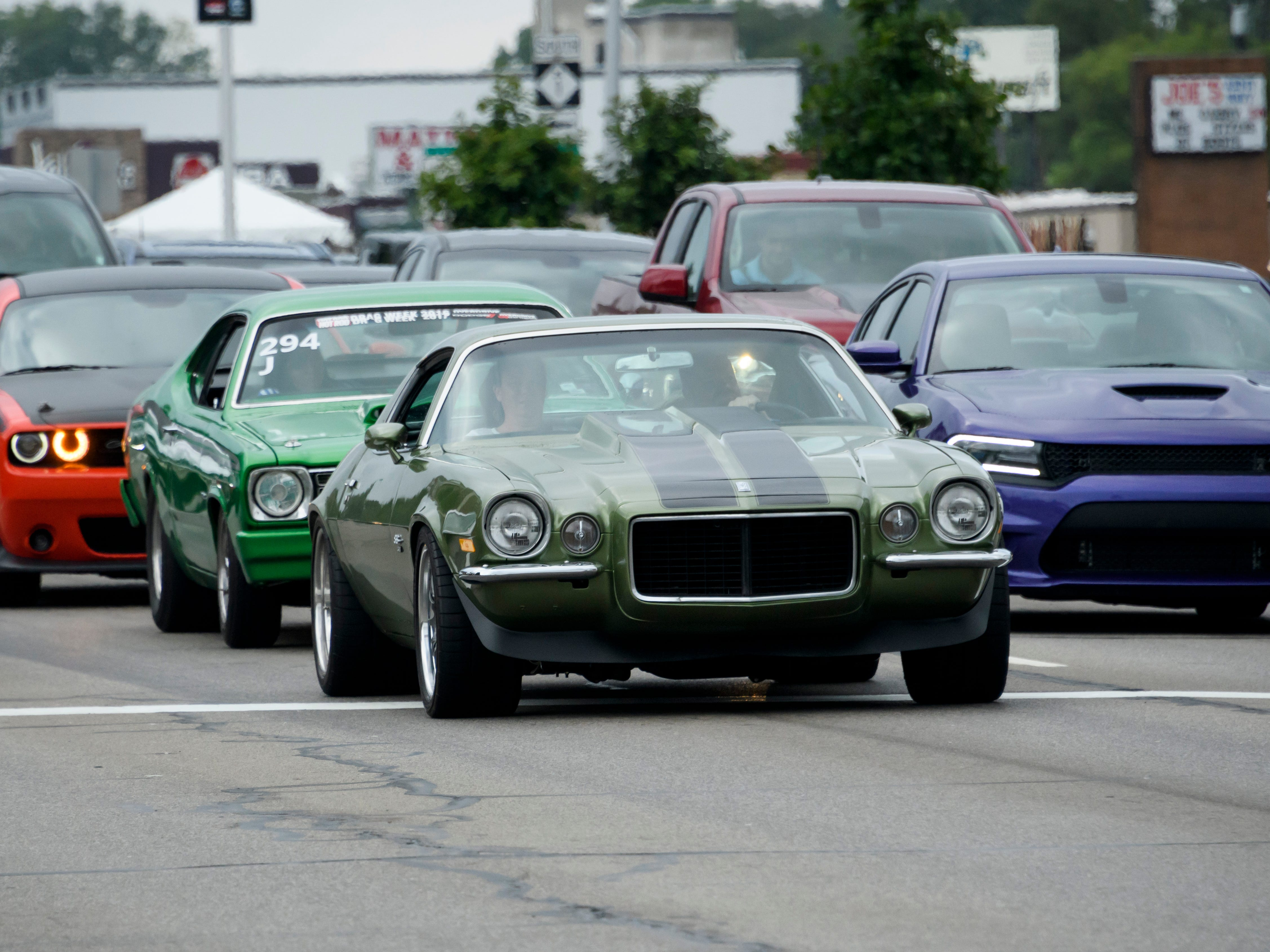 Classic cars of varying years line up Thursday at a red light on Woodward near Normandy in Royal Oak in preparation for the Dream Cruise.