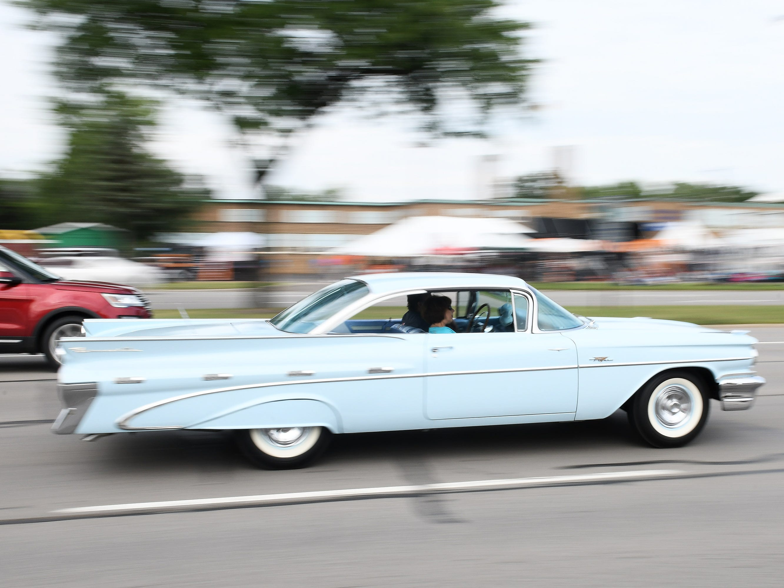 A classic car cruises Woodward in Berkley on Friday.