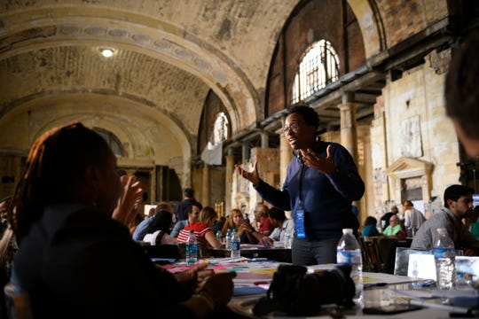 Jennyfer Darling, a deployment specialist for Ford, acts as a facilitator for a tableful of young entrepreneurs brainstorming ideas for how Ford should develop the Michigan Central Depot train station into a workspace that will entice people to want to work there, August 17, 2018.
