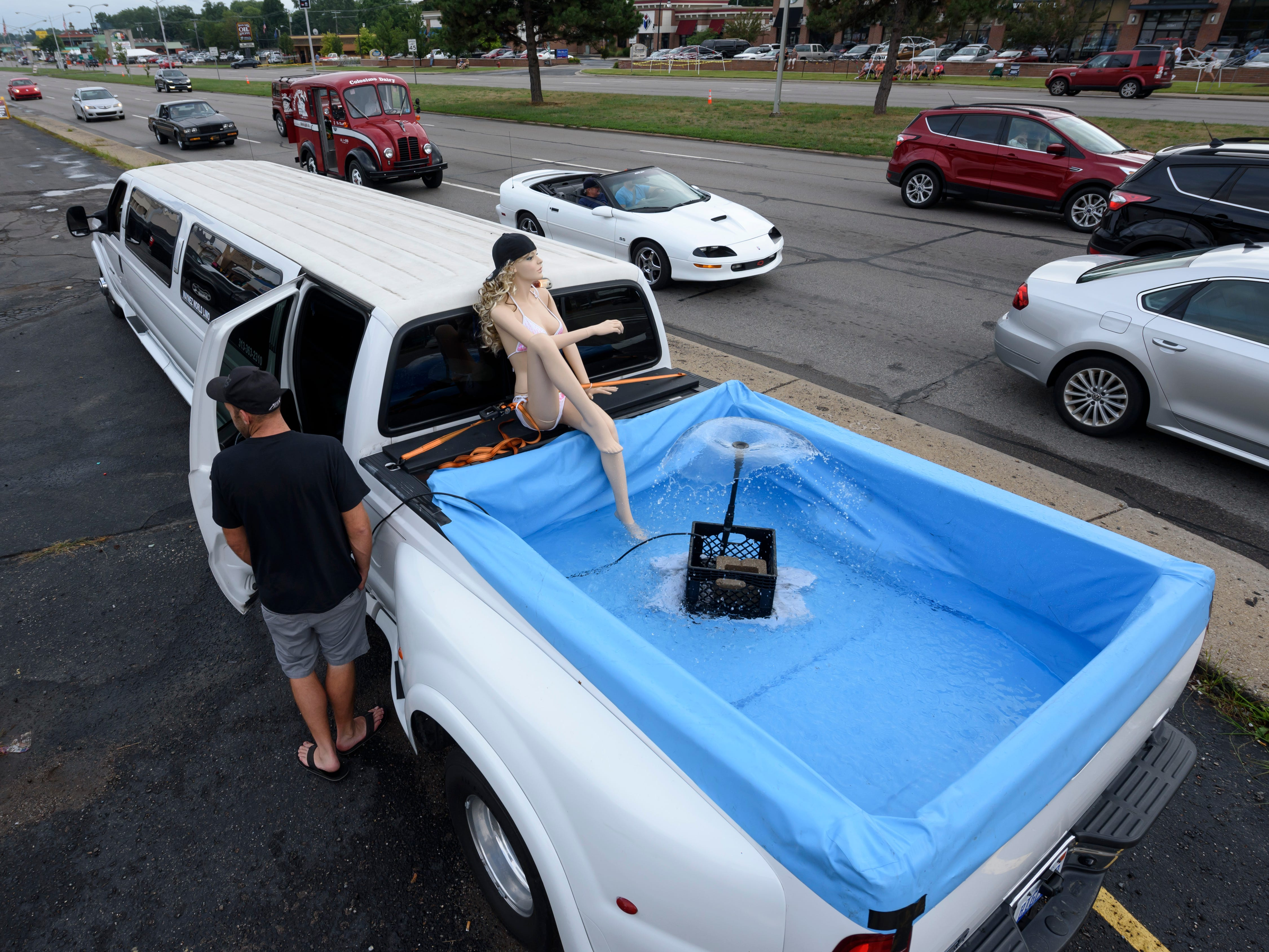 A 37-foot 2002 Ford F-250 converted limousine with included pool owned by Wayne Ferris of Dearborn Heights sits on Woodward near Normandy in Royal Oak in preparation for the Dream Cruise, Aug. 16, 2018.