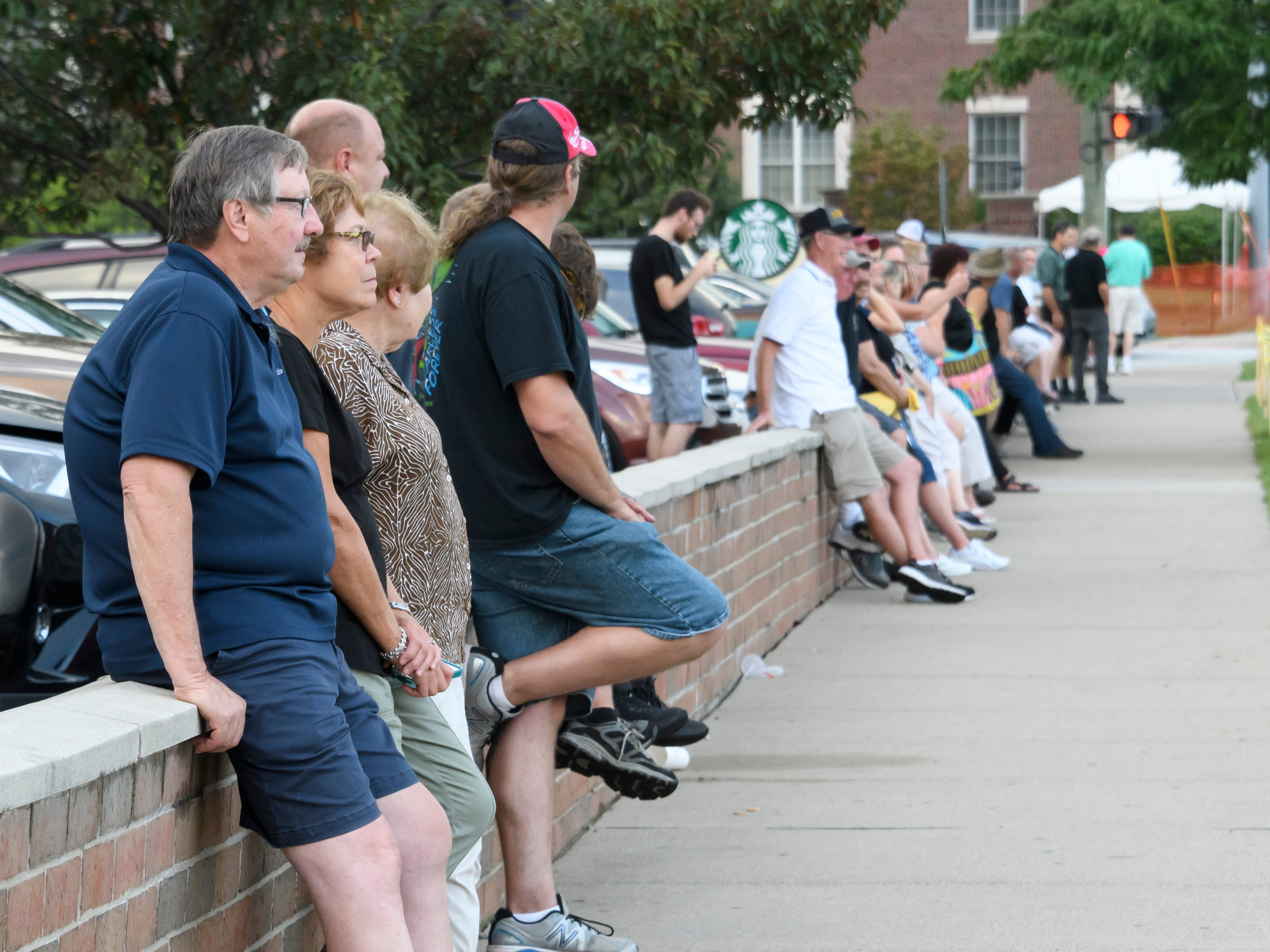 Groups of people line Woodward near Normandy Thursday in Royal Oak to watch cars cruise past.
