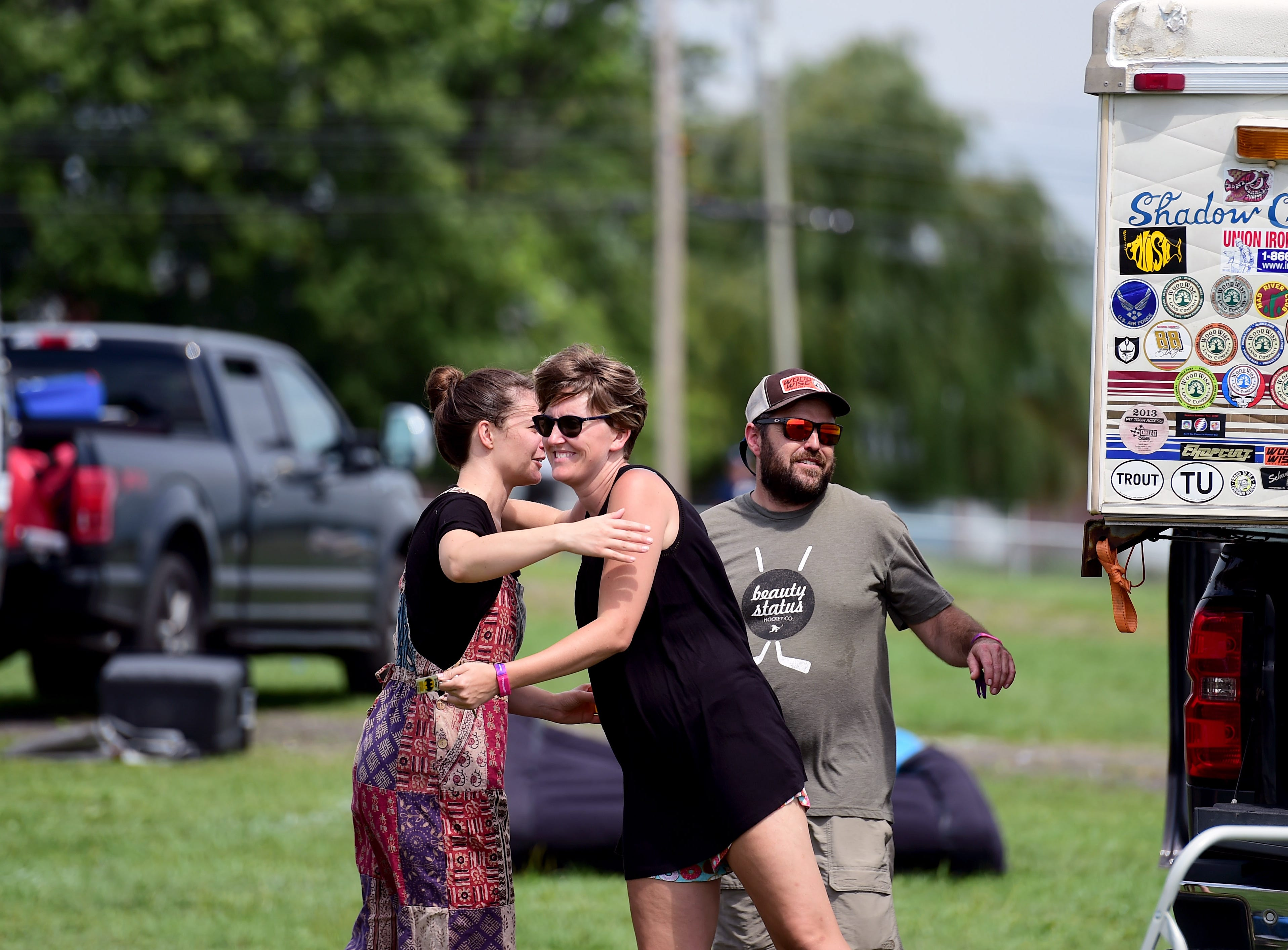 Phish fans Stephanie Balfoort of Rochester, Corbett of Chicago and Dan Prokupets of Honeoye Falls say goodbye and prepare to leave Watkins Glen International on Friday, August 17, 2018. The three-day Curveball Festival was cancelled on Thursday night due to water quality issues on the site.