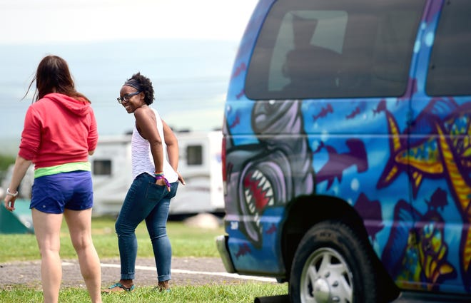 Steph Wheeler, right, of Washington, D.C. area says goodbye to friends as Phish fans break down their camps and prepare to leave Watkins Glen International on Friday, August 17, 2018. The three-day Curveball Festival was cancelled on Thursday night due to water quality issues on the site.