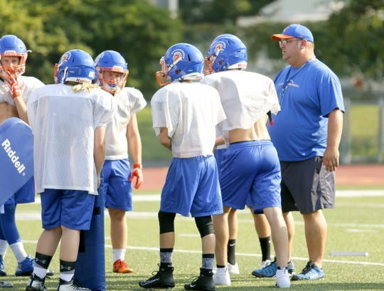 Kyle Erickson leads the Thomas A. Edison football team at practice Aug. 16 at Edison High School.