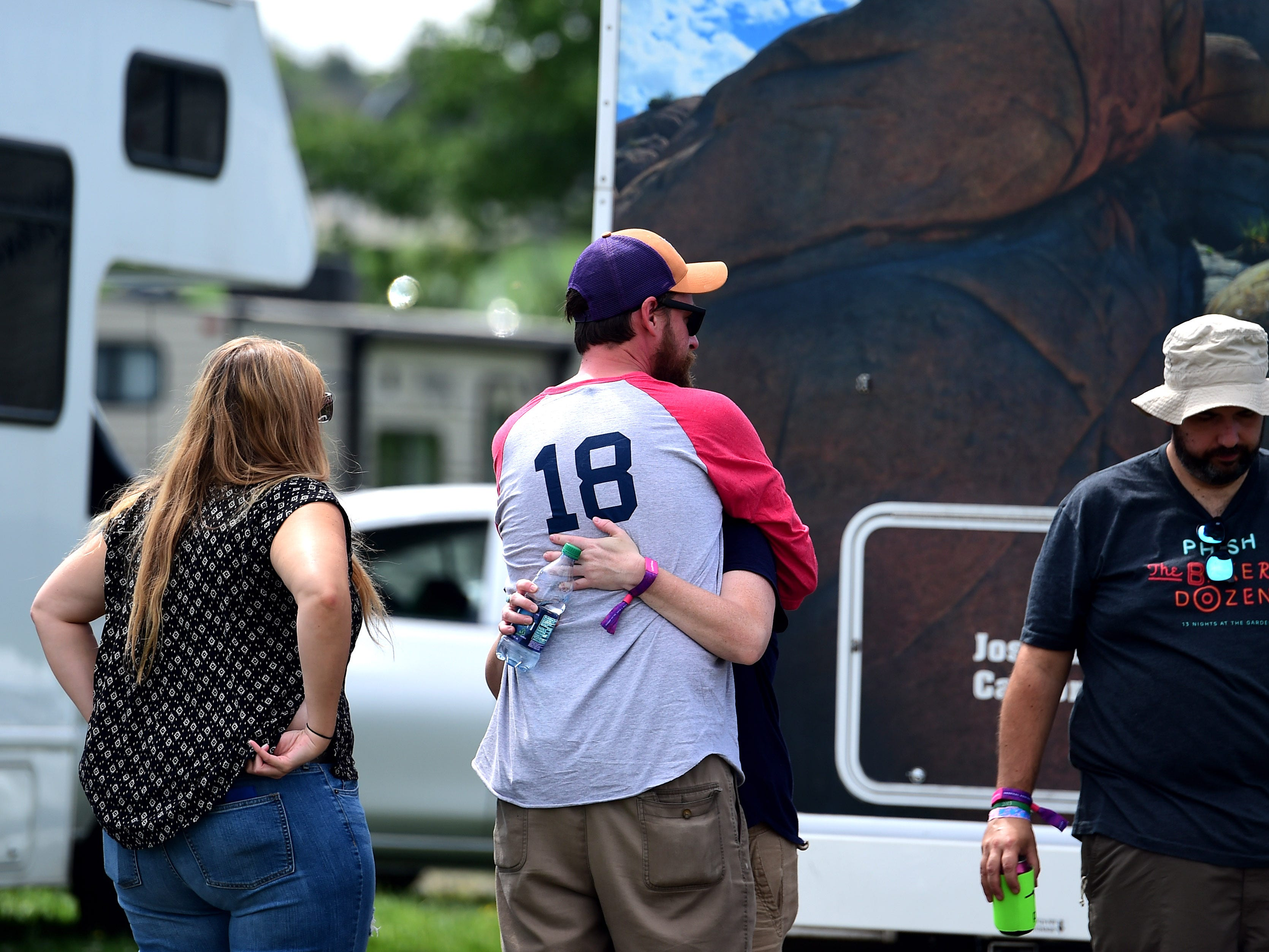 Phish fans hug goodbye at Watkins Glen International on Friday, August 17, 2018. The three-day Curveball Festival was cancelled on Thursday night due to water quality issues on the site.