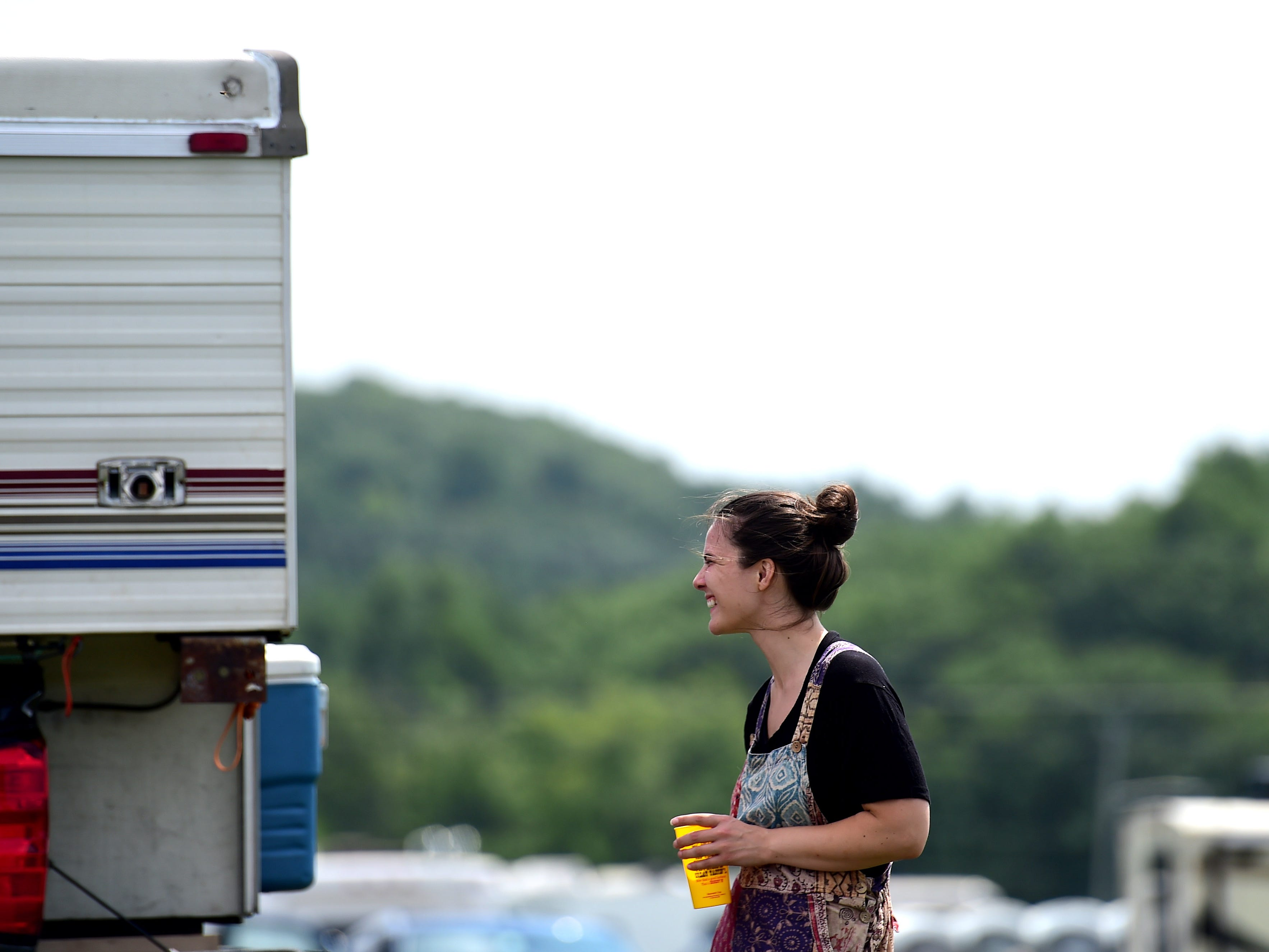 Stephanie Balfoort of Rochester gets ready to leave Watkins Glen International on Friday, August 17, 2018. The three-day Curveball Festival was cancelled on Thursday night due to water quality issues on the site.