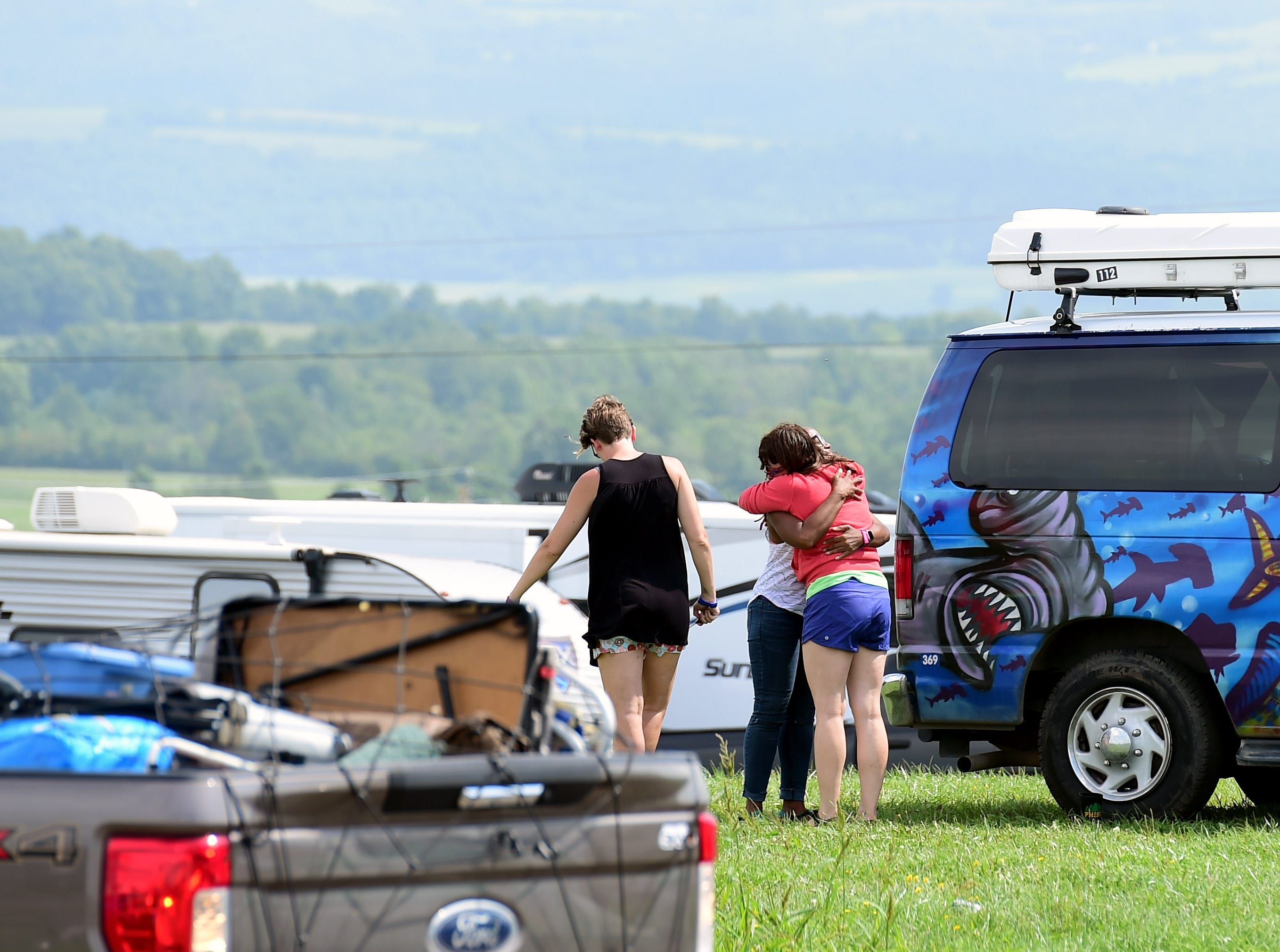 Phish fans from Chicago, Texas and Washington, D.C., prepare to leave Watkins Glen International on Friday, August 17, 2018. The three-day Curveball Festival was cancelled on Thursday night due to water quality issues on the site.