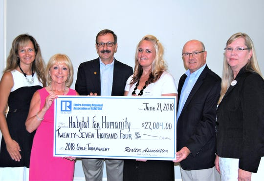 A recent golf tournament sponsored by the Elmira-Corning Regional Association of REALTORS raised more than $27,000 for Habitat for Humanity. From left are association President Michelle Costanza, tournament co-chair Joanne Laux, Schuyler County Habitat President Bob Groll, Southeast Steuben County Habitat Executive Director Lisa Caracci, tournament co-chair Ken Leath and Chemung County Habitat President Chris Snyder.