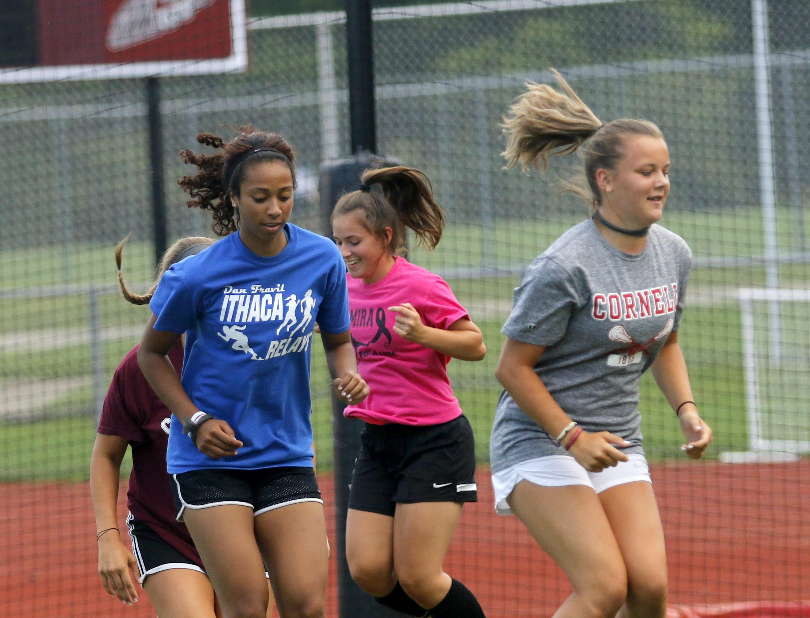 The Elmira High School girls soccer team practices Aug. 16 at Ernie Davis Academy's Marty Harrigan Athletic Field.