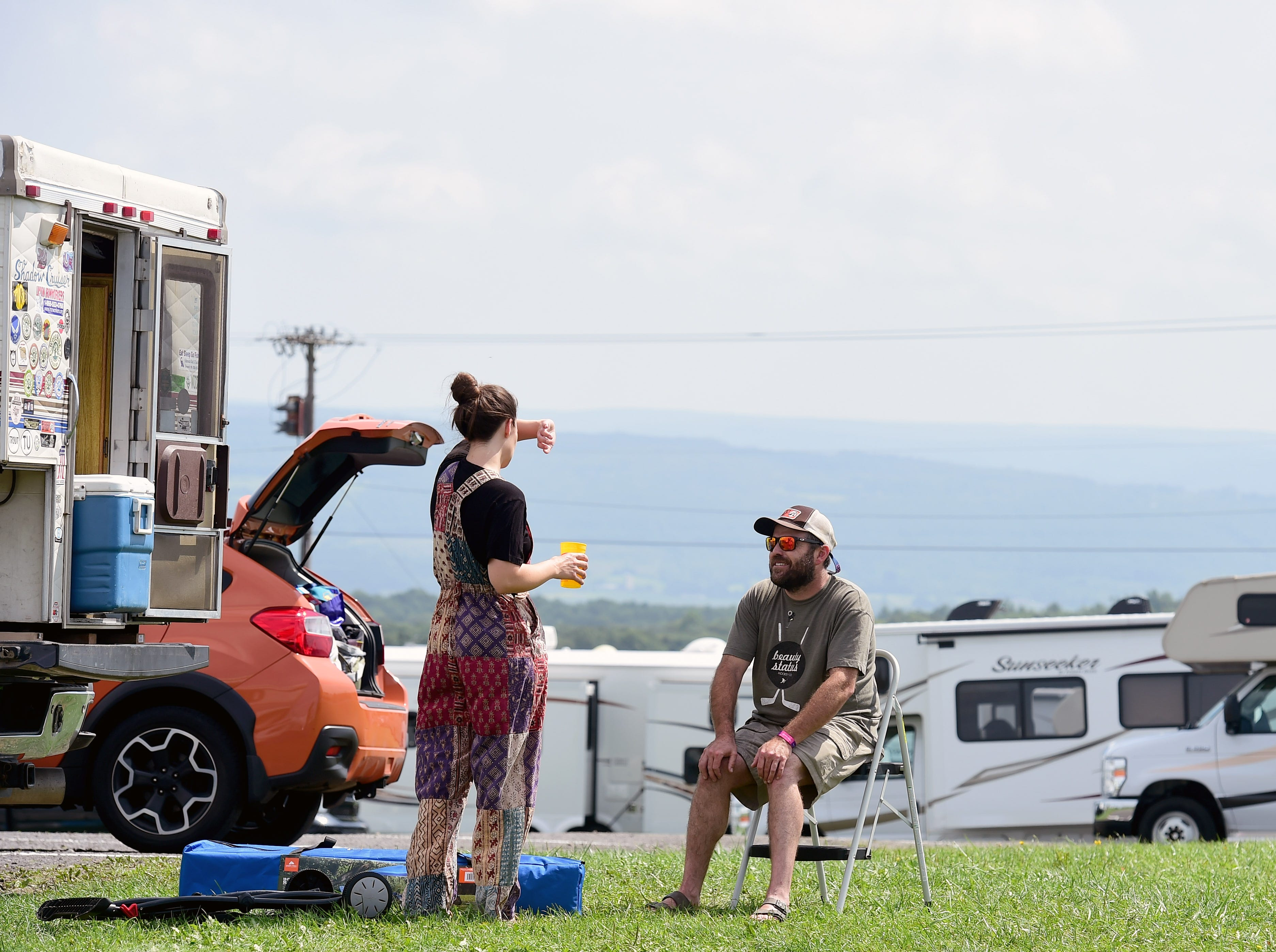 Phish fans Stephanie Balfoort of Rochester and Dan Prokupets of Honeoye Falls prepare to leave Watkins Glen International on Friday, August 17, 2018. The three-day Curveball Festival was cancelled on Thursday night due to water quality issues on the site.