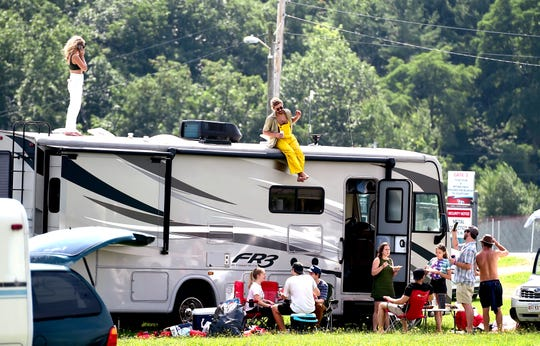 Phish fans break down their camps and prepare to leave Watkins Glen International on Friday, August 17, 2018. The three-day Curveball Festival was cancelled on Thursday night due to water quality issues on the site.