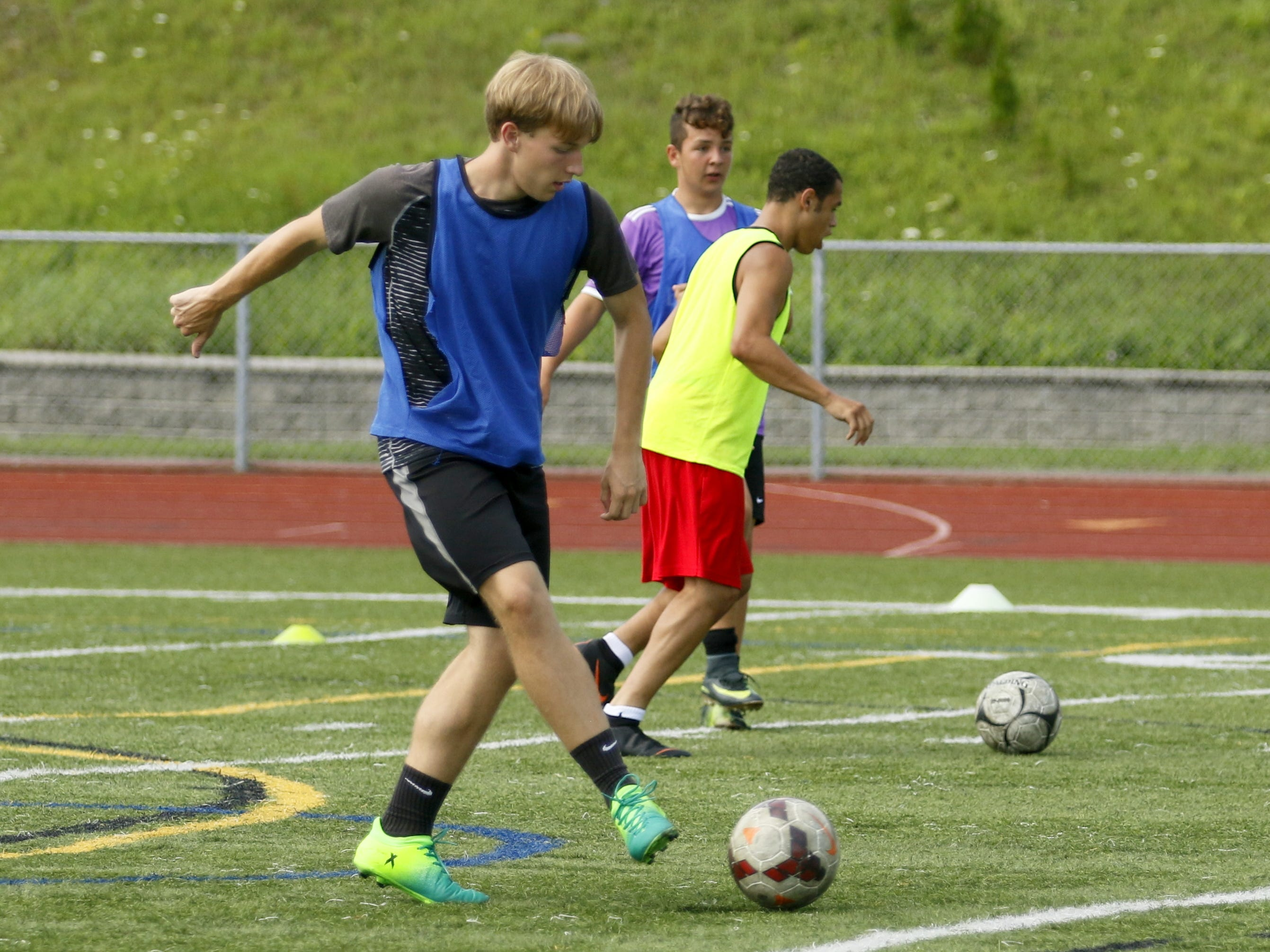 The Elmira High School boys soccer team practices Aug. 17 at Marty Harrigan Athletic Field at Ernie Davis Academy.