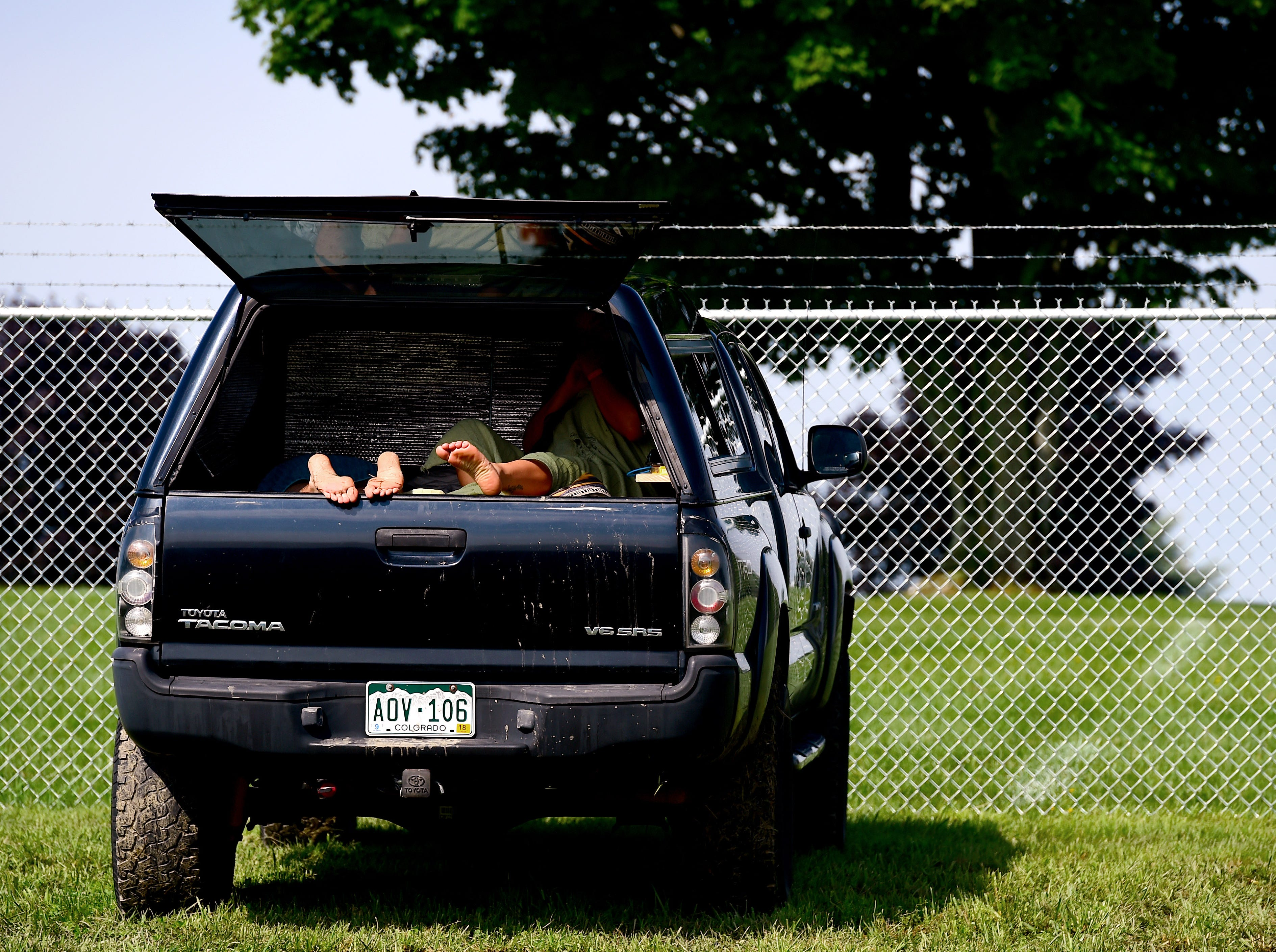 Phish fan Ali Yanni of Portland Maine (in truck, with her boyfriend) arrived at Watkins Glen after the gates were closed early Thursday night following the announcement that the three-day Curveball Festival was cancelled due to water quality issues on the site. The couple, who camped outside the gates, was meeting friends at the festival, some who traveled from South Carolina, Colorado and California. Friday, August 17, 2018.
