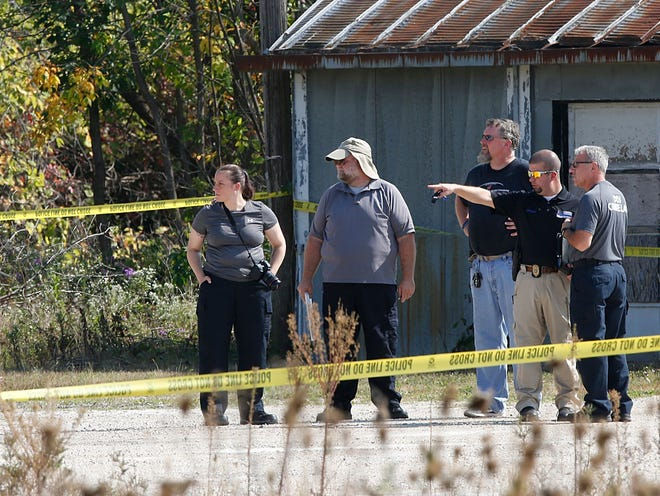 City of Fond du Lac detective Bill Ledger points to an area where a body of a deceased male was found on Sept. 23, 2017, later identified as Logan Foster, was found along Forest Avenue at the railroad tracks in Fond du Lac. He is joined by investigators from the State of Wisconsin Division of Criminal Investigation Crime Lab Response Team. Doug Raflik/USA TODAY NETWORK-Wisconsin.