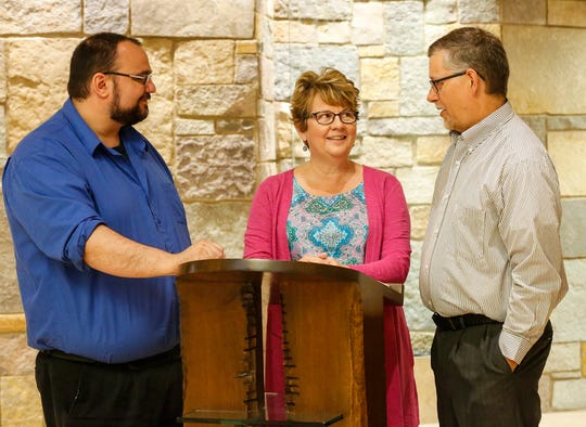 Agnesian HealthCare Chaplains Peter Capoyianes, Dawn Vandenberg and Bill Schuerman pictured in the St. Agnes Hospital Chapel.