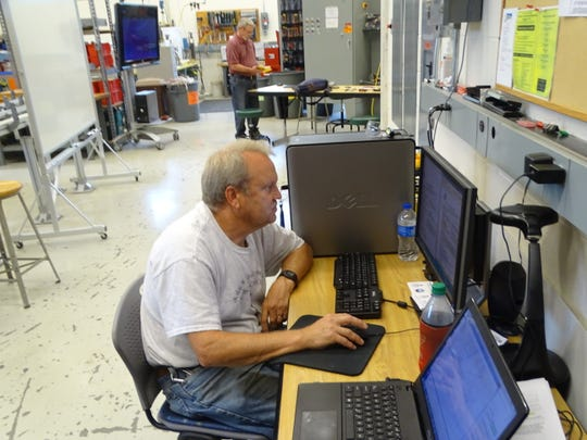 Mike Holewinski, assistant electricity and power controls professor at Terra State Community College, prepared inside his lab Friday for the start of classes next week.