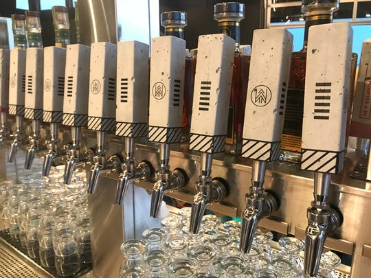 Tap handles at New Belgium's new Denver taproom called The Woods at The Source Hotel.