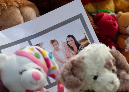 A photograph sits amid the tributes outside the home where Shanann Watts, and her two daughters, Bella and Celeste, lived Aug. 16, 2018, in Frederick, Colorado.