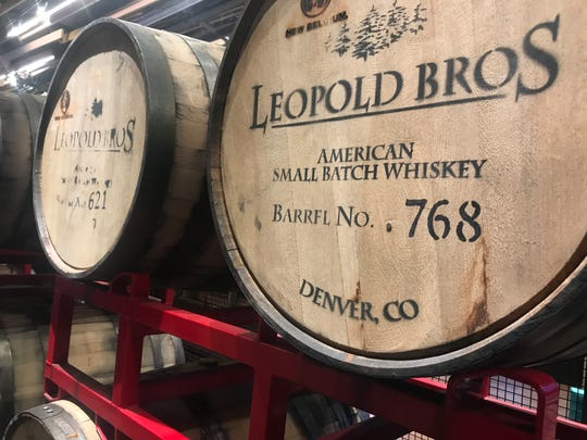 Leopold Bros. wooden barrels decorate New Belgium's new Denver taproom called The Source.