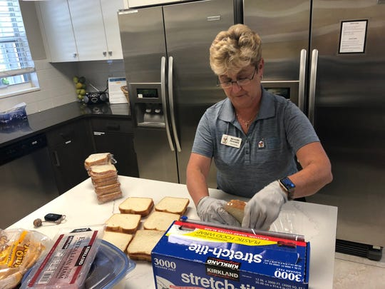 Volunteer Beverly Fewster prepares bagged lunches for families who stop by the program's Family Room at Golisano Children's Hospital.