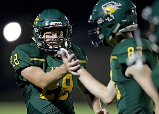 Preble Hornets running back Kody Joski celebrates his touchdown run against Ashwaubenon High School at Preble High School Thursday, August 16, 2018 in Green Bay, Wis.
